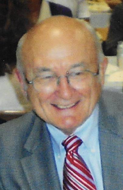 Thomas  E.  Schmittling