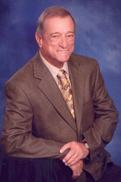 Tom L. Grimes