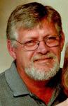 Douglas E. Greiner