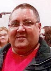 Timothy L.  Hausmann
