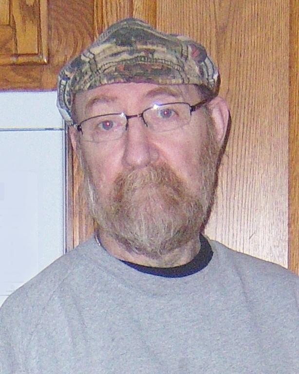 Mark E. Hartman