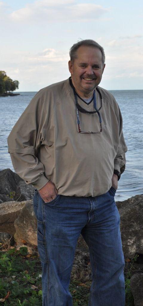 Mark J.  Duvelius