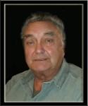 Larry E.  James